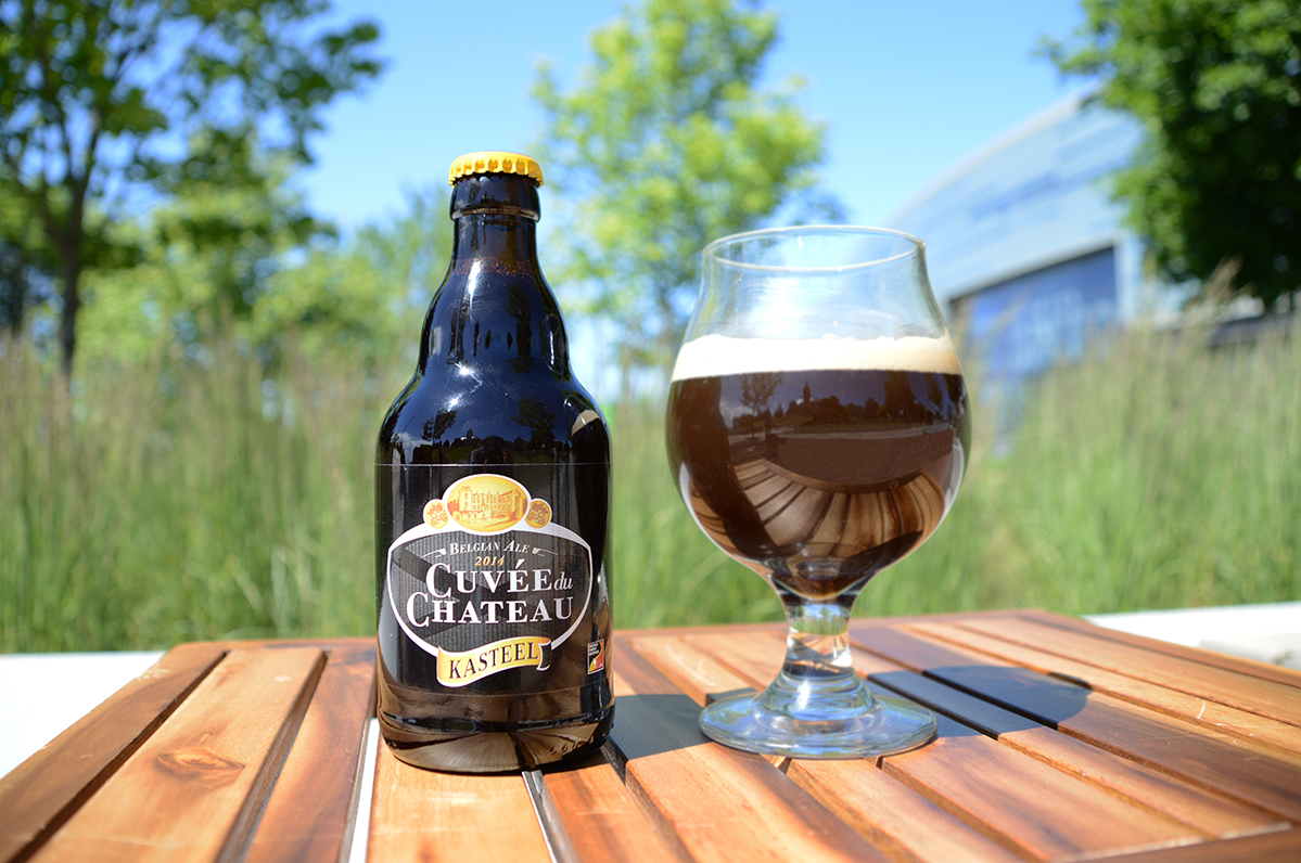 Kasteel beer bottle next to a glass of beer