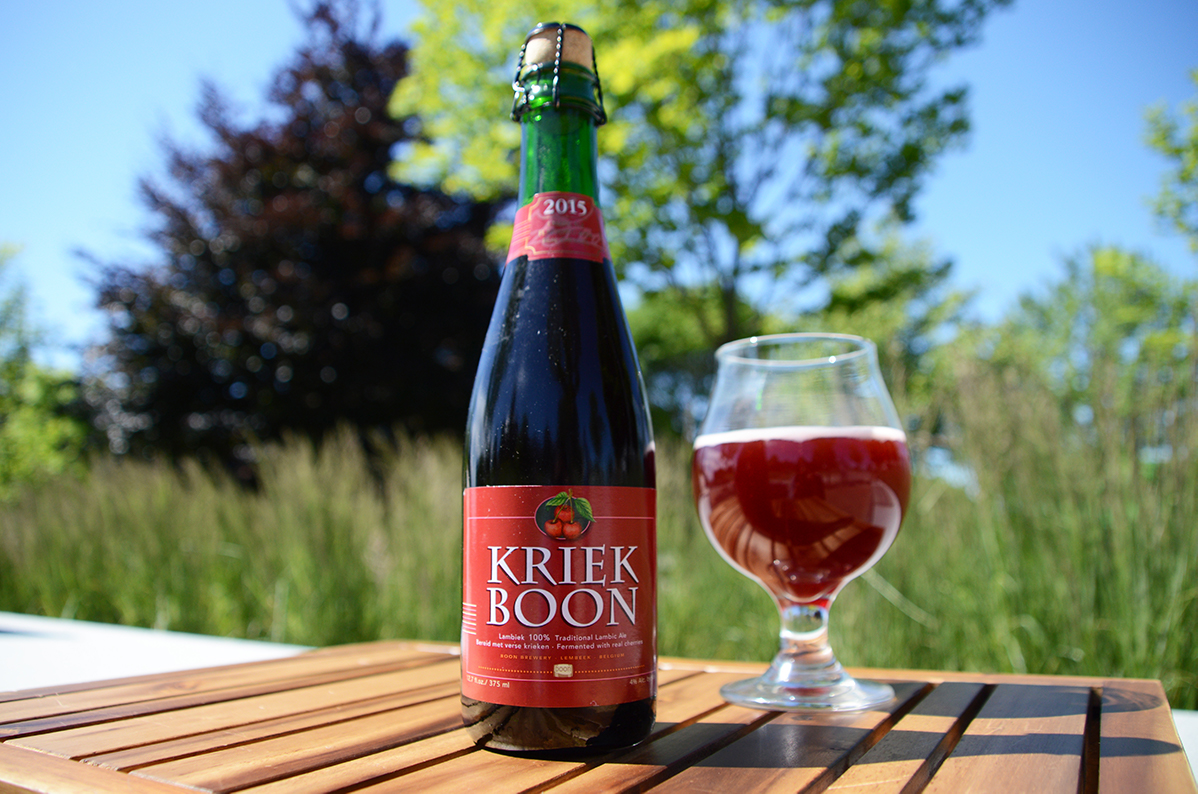 Boon Kriek beer bottle next to a glass of beer