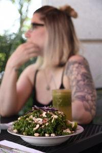 vegan salad in front of kristin