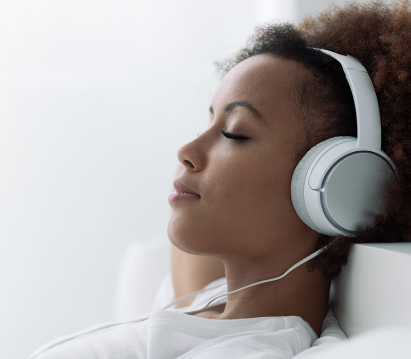 woman meditating with headphones
