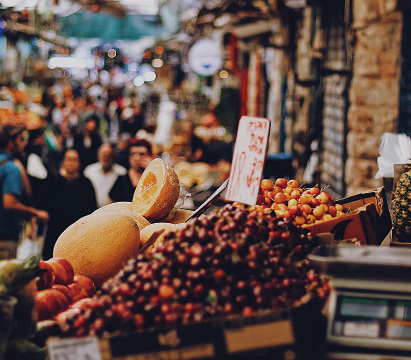 nuts and fruits on a table at a market